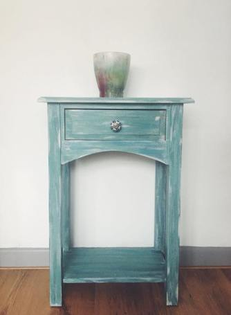 CALM SEAS. Solid wood console table with drawer, painted in shades of blue and sea green. Selling for £80.