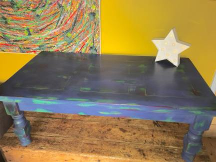 MOODY BLUES. Revived solid coffee table in beautiful colours of blue with splashes of green and red. Waxed finish. L110cm W60cm D40cm. Special offer at £95.
