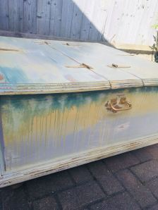 "SPRNGTIME Beautiful chest style coffee table that also has storage space inside. Heavily distressed in tones of yellow/green and grey. Gold leaf applied to ironwork. 36 W x 36 W x 15"" H. £195"
